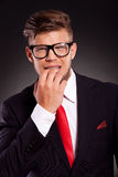 Business man bitting nails Royalty Free Stock Photo