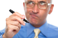 Business man with a black marker Royalty Free Stock Image