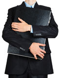 Business man in black suit hand holding briefcase Royalty Free Stock Image