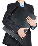 Business man in black suit hand holding briefcase Royalty Free Stock Photos