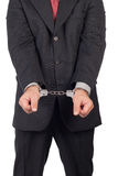 Business man with a black suit in handcuffs Royalty Free Stock Image