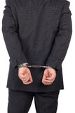 Business man with a black suit in handcuffs Stock Photo
