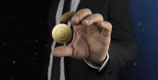 Business man with black suit holding bitcoin on hand Royalty Free Stock Photos