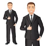 Business man in black suit smiles and shows thumbs up.  Royalty Free Stock Images