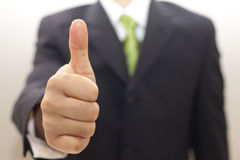 Business man in black suit with thumbs up Royalty Free Stock Photo