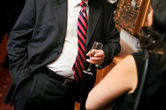 Business man with black suite and drink Royalty Free Stock Photography