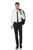 Business man in black suite on white background Stock Photos
