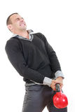 Business man in black sweater with shirt and pants lifting dubel Royalty Free Stock Photo