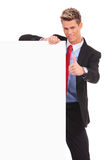 Business man with blank board making ok Royalty Free Stock Photography