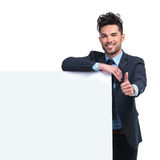 Business man with  blank board making the ok thumbs up gesture Royalty Free Stock Images