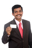 Business man with blank card Stock Images