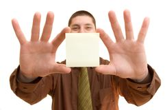 Business man with blank memo 2. Business man holding a blank memo note Stock Photos