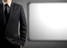 Business man and blank white board Stock Photo