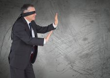 Business man blindfolded with grunge background Stock Photos