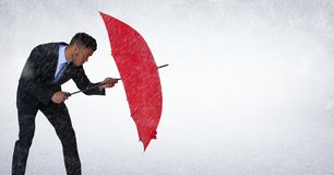 Business man blocking rain with umbrella against white background Royalty Free Stock Photos