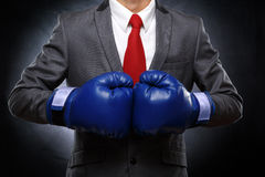 Business man in blue boxing  gloves Royalty Free Stock Image