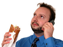 Business Man in Blue (Eating Lunch) Royalty Free Stock Photo