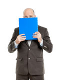 Business man with blue folder. An image of a handsome business man with a blue folder royalty free stock images