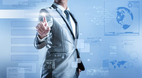 Business man in blue grey suit pressing on button screen Stock Image