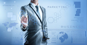 Business man in blue grey suit using digital pen working with di Stock Photos