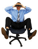 Business man with blue tie with binoculars on the office chair Stock Photo
