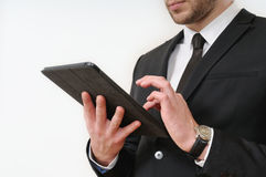 Business man body side in black suit holding his tablet on white Stock Photos