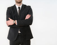 Business man body side folded his arms in black suit on white ba. Part of business man body side folded his arms in black suit on white background; business Stock Photos