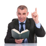 Business man with book points up Stock Photos
