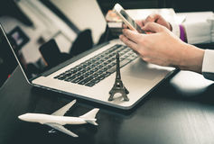 Business man is booking trip on phone. Business man is booking paris trip on phone royalty free stock image