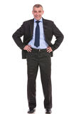 Business man with both hands on hips Royalty Free Stock Photography