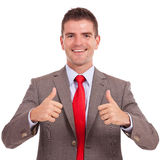Business man both thumbs up. Young happy business man holding both thumbs up Royalty Free Stock Image