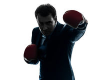 Business man boxer with boxing gloves  silhouette Stock Photo