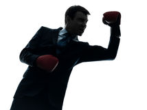 Business man boxer with boxing gloves  silhouette Stock Images