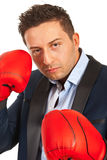 Business man with boxing gloves Stock Photos