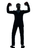 Business man with boxing gloves  silhouette Stock Photos