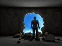 Business man breaking trough a wall Royalty Free Stock Photography