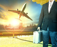 Business man and breifcase standing in airport terminal building Royalty Free Stock Photos