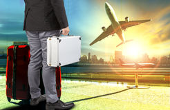 Business man and breifcase ,traveling luggage standing in airpor Royalty Free Stock Photo