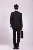 Business man & brief, back view Royalty Free Stock Photos