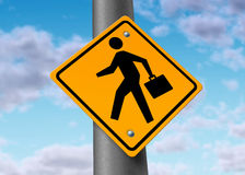 Business man with a brief case on a road sign Stock Photos
