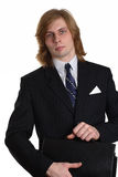 Business man with briefcase. Portrait of a young man with long blond hair in a business suit carrying a briefcase.  White background Royalty Free Stock Image