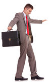 Business man with briefcase balancing Royalty Free Stock Photography