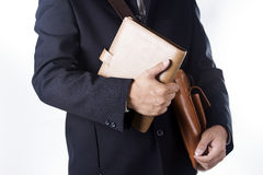 Business man with briefcase and hold book Royalty Free Stock Image