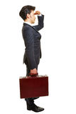 Business man with briefcase looking forward Stock Photo
