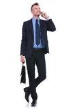 Business man with briefcase on the phone Royalty Free Stock Image