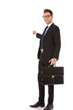 Business man with briefcase presenting Stock Photo