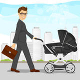 Business man with briefcase pushing pram, baby carriage or stroller Royalty Free Stock Photos