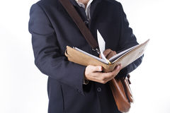 Business man with briefcase and reading the book Stock Photo