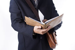 Business man with briefcase and reading the book Royalty Free Stock Image