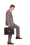 Business man with briefcase stepping Royalty Free Stock Images